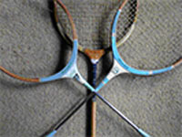 crossed badminton racquets